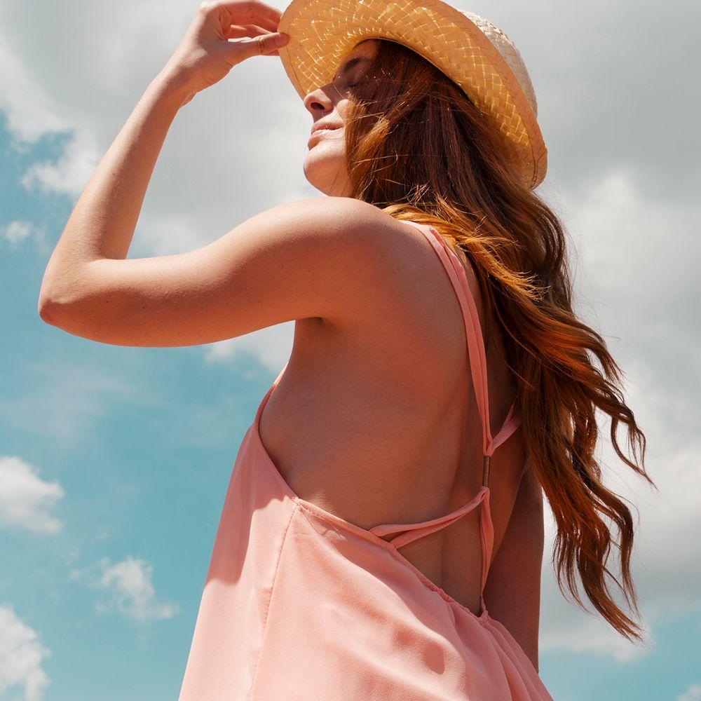 person outside in sun dress