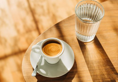 Coffee and glass on a tabletop