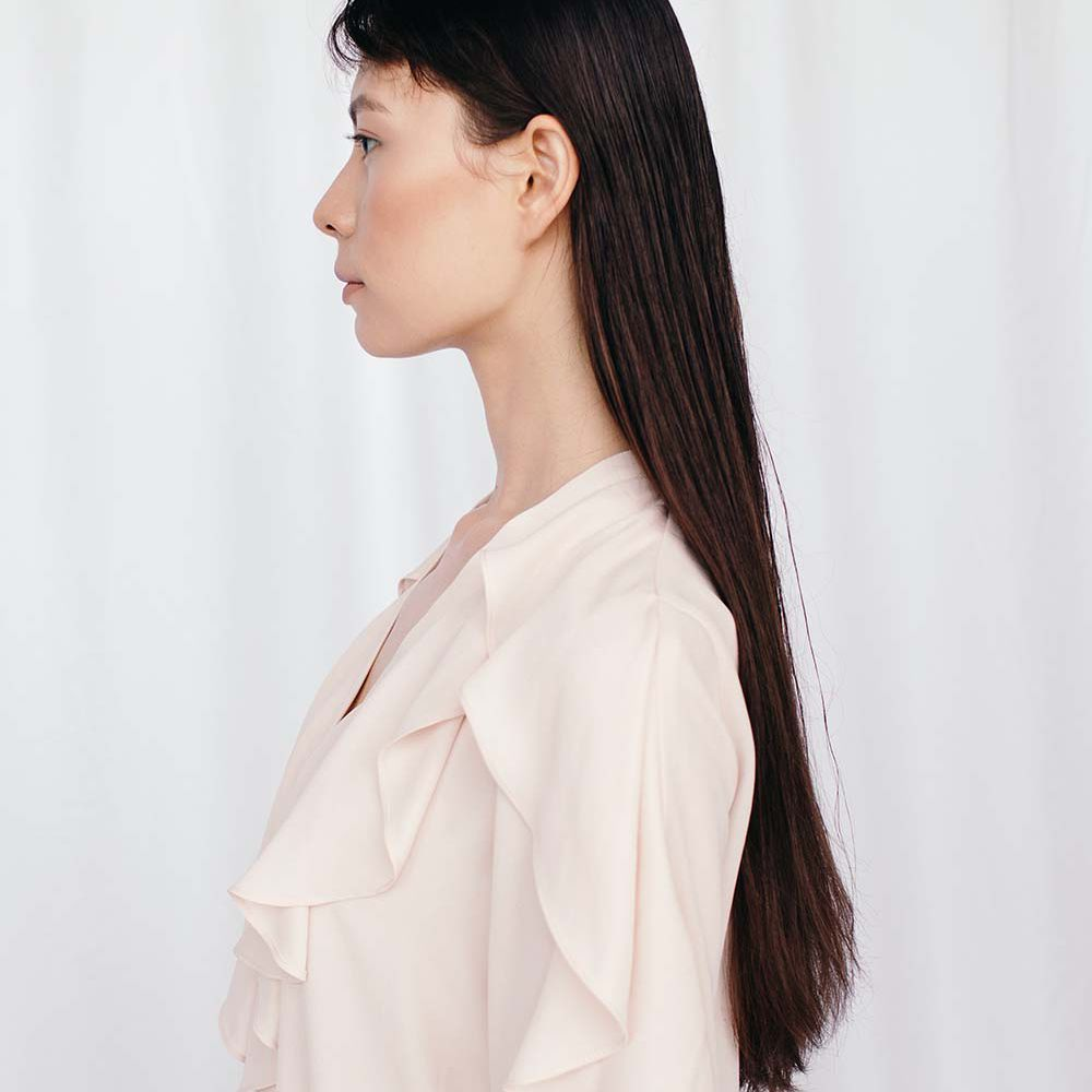 portrait of asian femme with straight hair