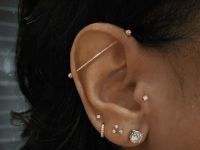 Woman with many ear piercings
