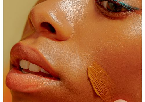 closeup of person applying foundation