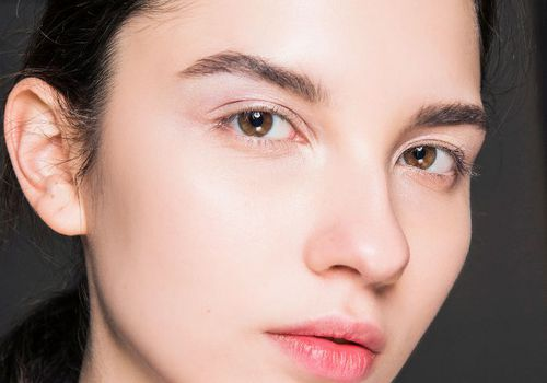 model with black hair and minimal makeup