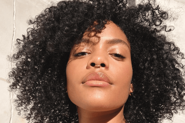 woman with natural hair glowing in sunlight