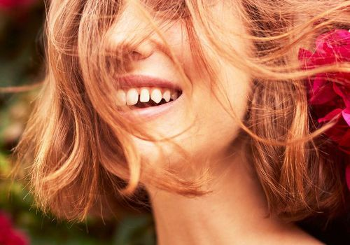 smiling woman with glowing skin