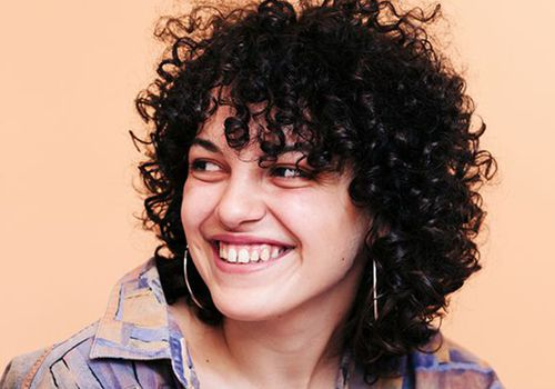 woman with spiral perm