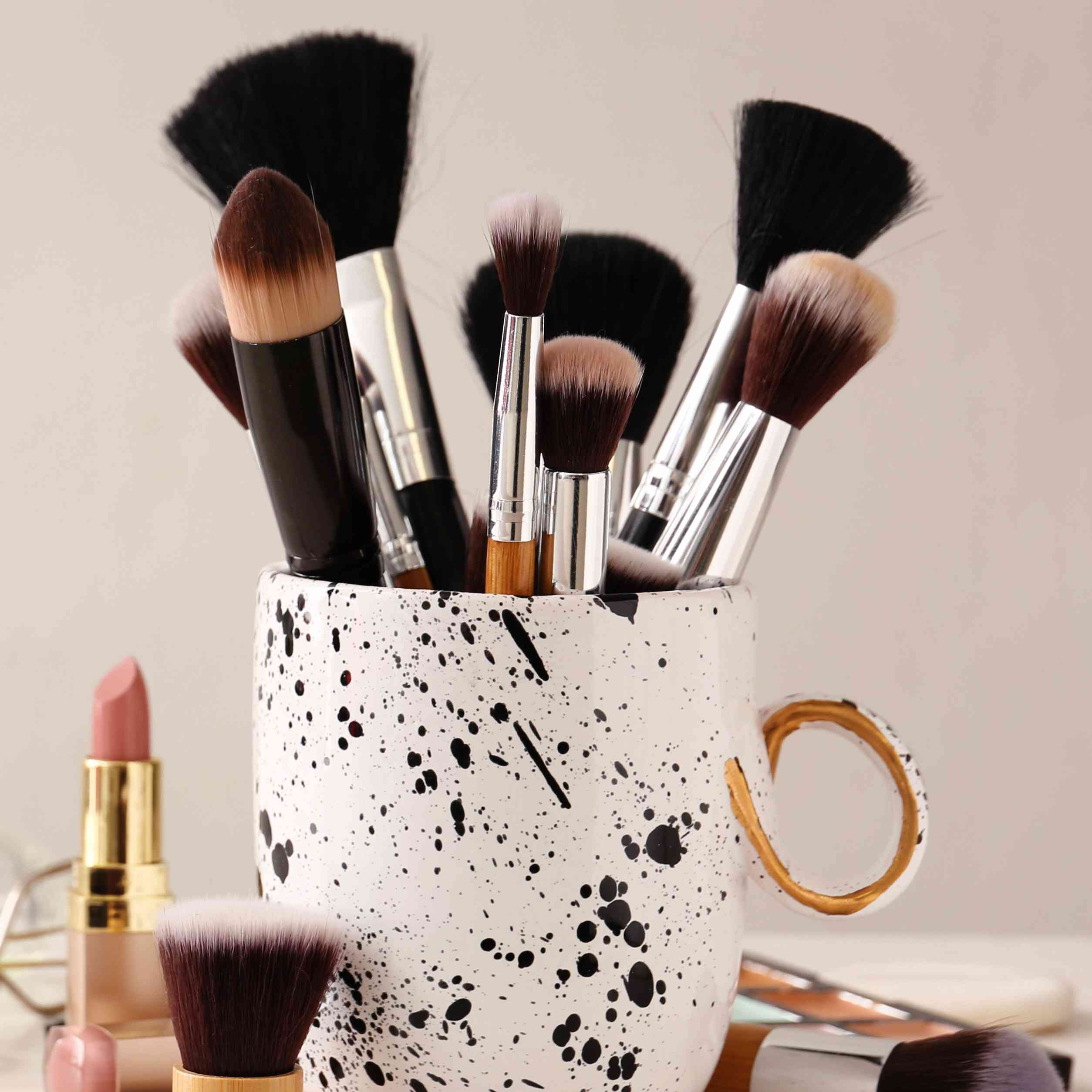 Makeup brushes in coffee cup