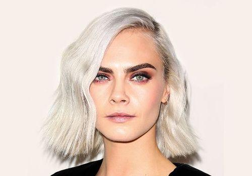 Cara Delevingne with platinum blonde hair