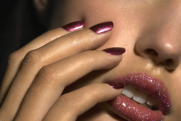 woman with metallic nails