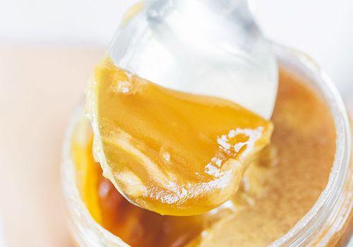 spoon in almond butter