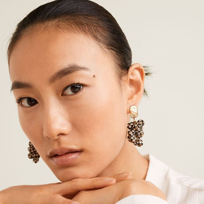 Foundation Tips: Woman with bold earrings