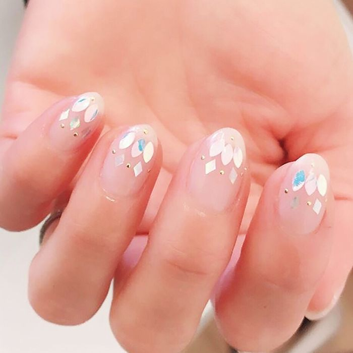 Hand with metallic embellishment manicure