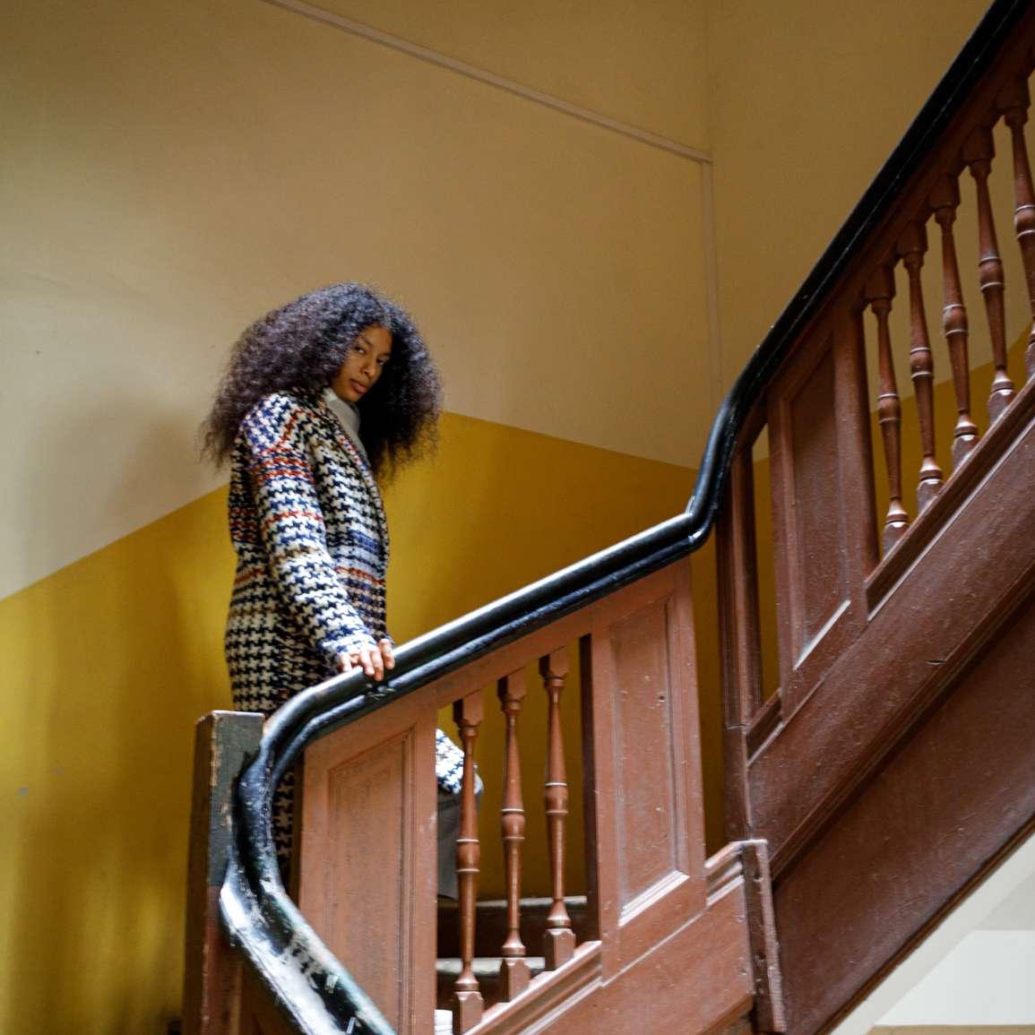 black femme in stairwell