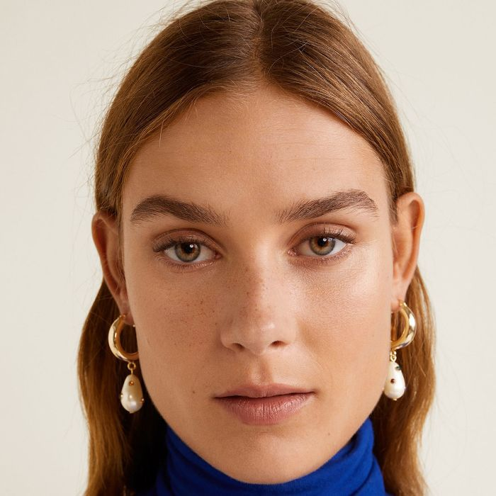 Best Cleanser for Dry Skin: Woman with blue roll neck