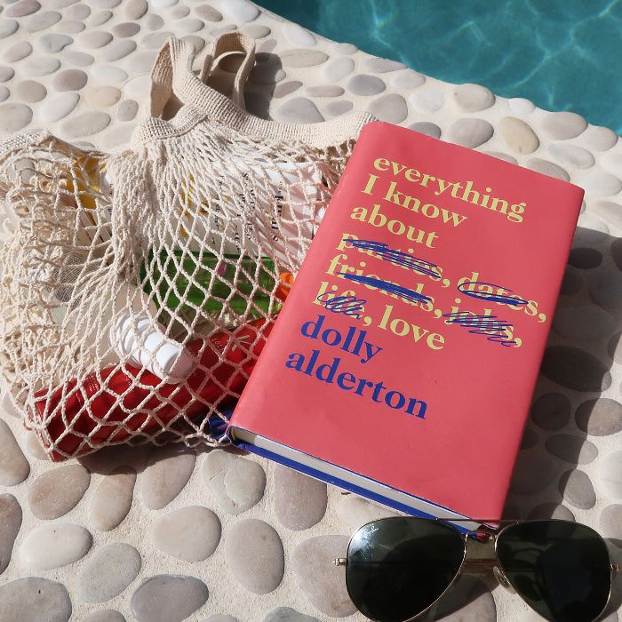 Poolside beauty products: book and sunglasses