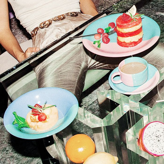 Foods to avoid before bed: woman looking at a plate of food