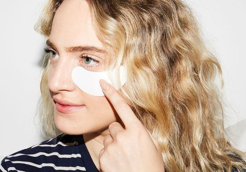 woman with under eye patches on