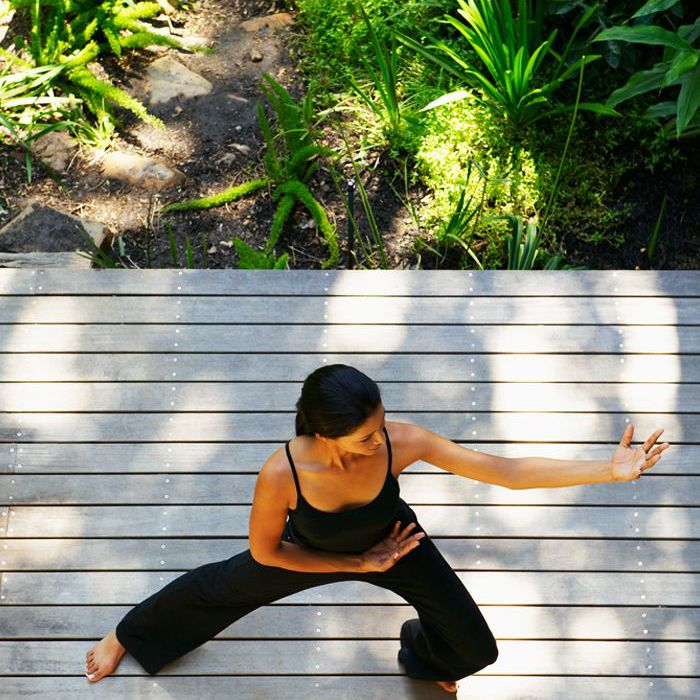 Tai chi benefits: Woman practicing tai chi outdoors