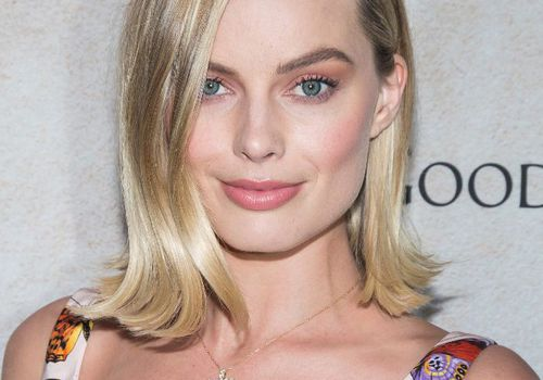 Margot Robbie sleek lob with hair flipped out