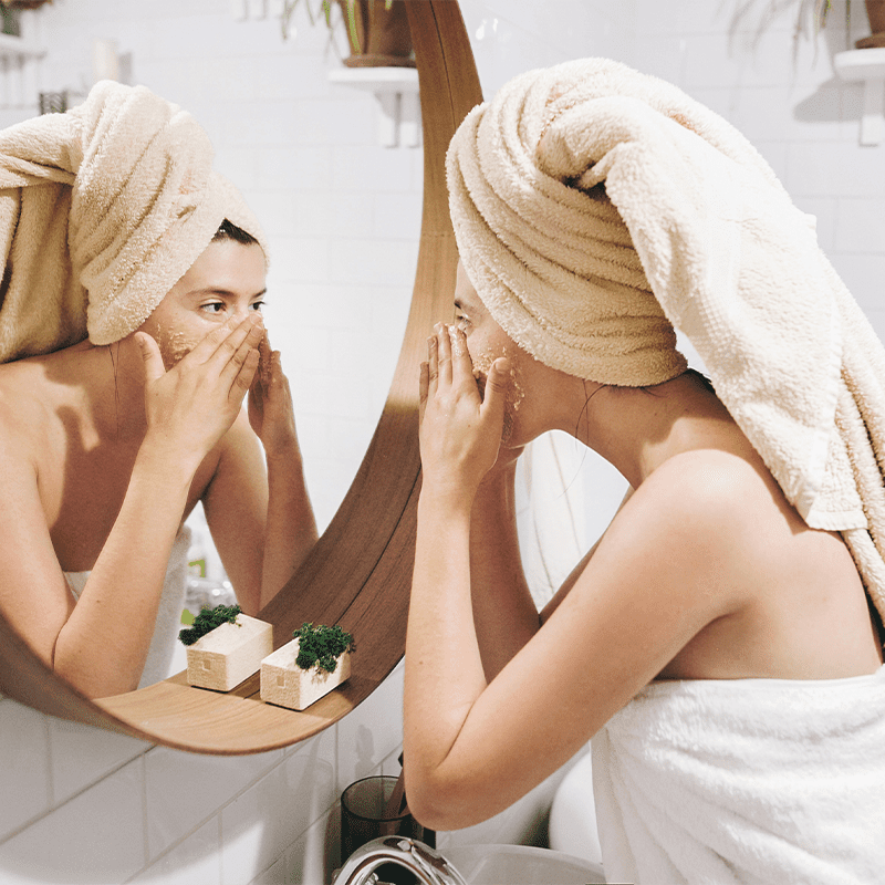 Woman putting on mask