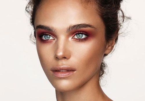model with cranberry eye makeup