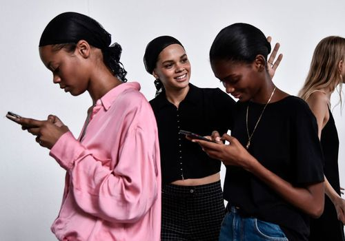 women looking at phone