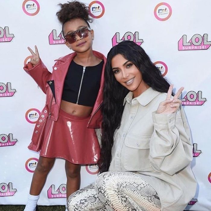 Kim Kardashian and North West posing making peace signs