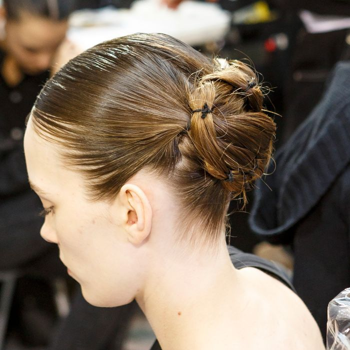 Model with hair pulled up in intricate bun