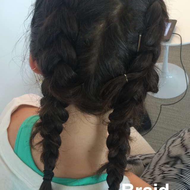 women with braids on her head