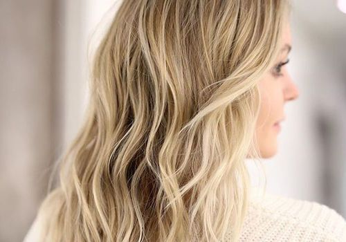 Back of woman with blonde, wavy hair