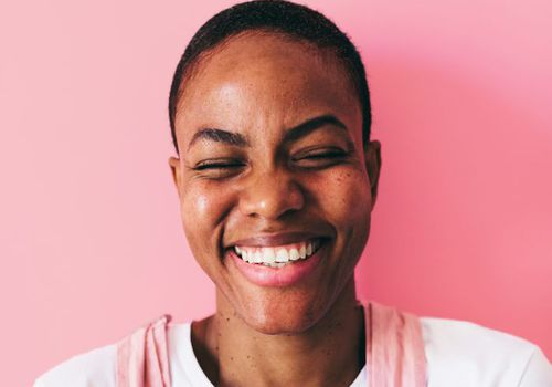 woman with short hair laughing