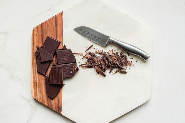 dark chocolate on board with knife