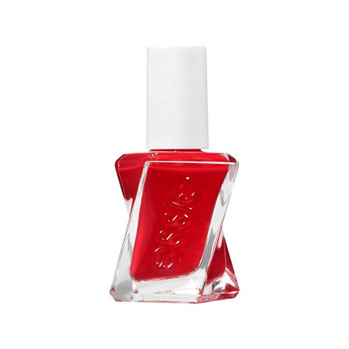 Bottle of red nail polish on a white background.