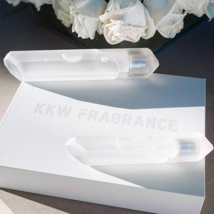 Bottles of Crystal Gardenia perfume on top of a white box