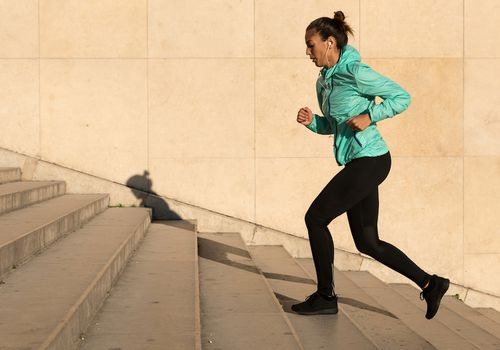 Woman runs up stairs