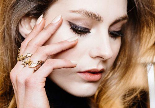 Black Shimmer Eyeliner on a model looking downwards.