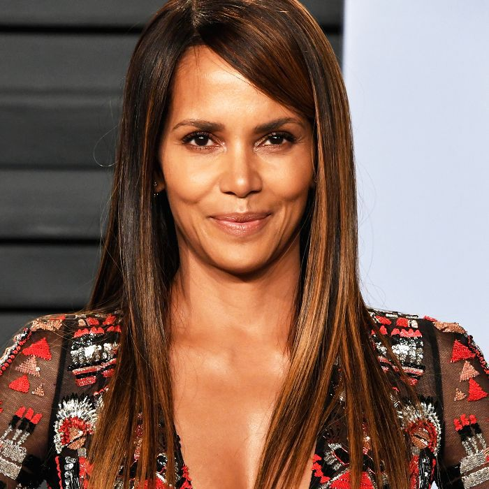 Halle Berry long, straight hair with sleek side bangs