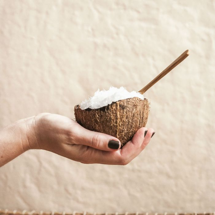 Coconut with spoon in it