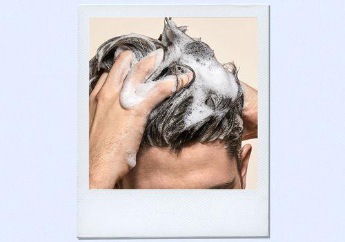 man using thickening shampoo on hair