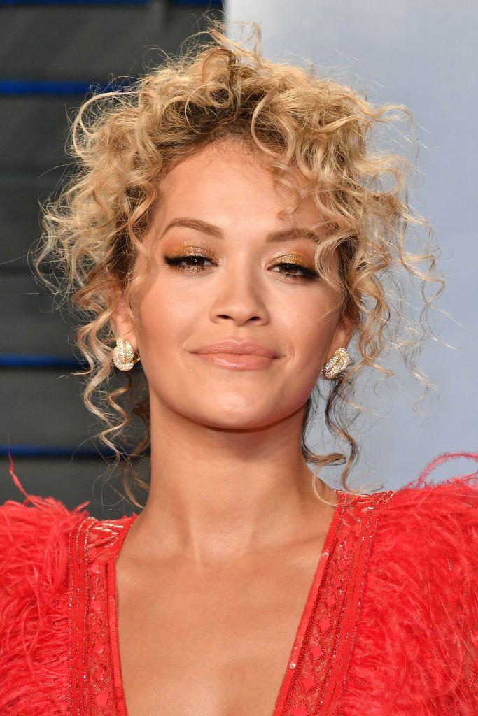 Rita Ora loose, curly updo