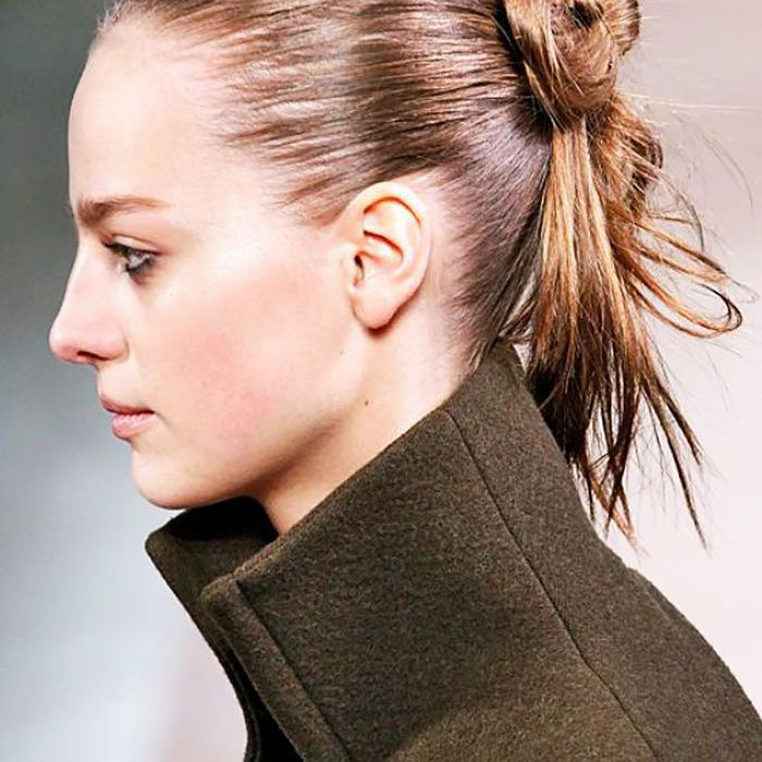 Model with a messy bun with the ends hanging loose