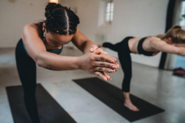 women taking hot yoga class