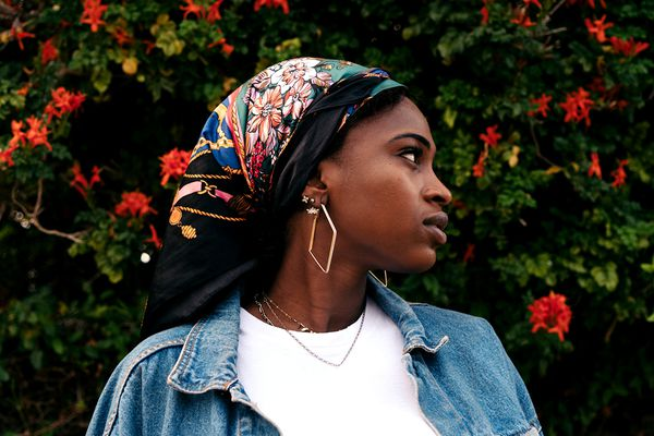 person in bandana with piercings