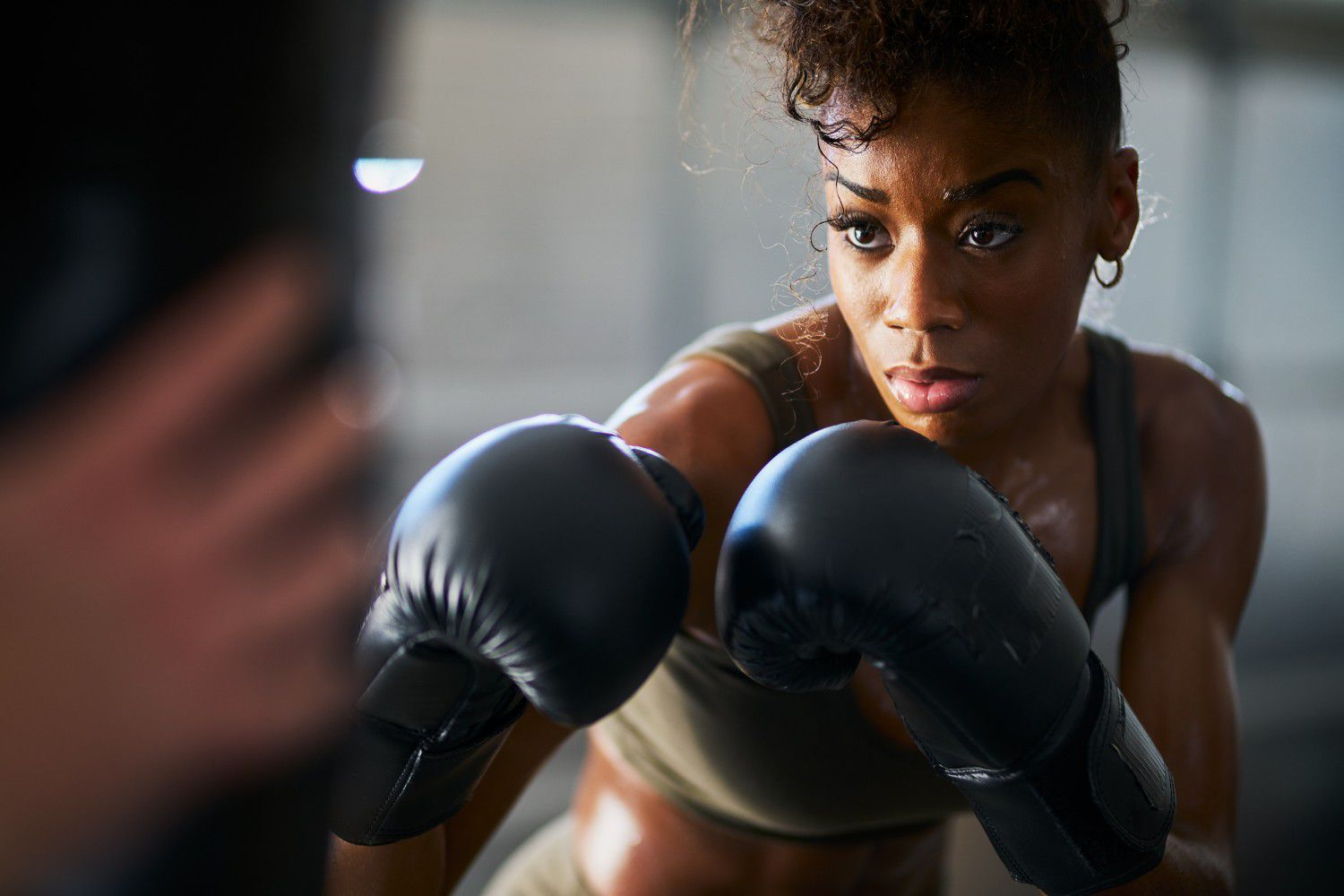 Woman with curly hair boxing