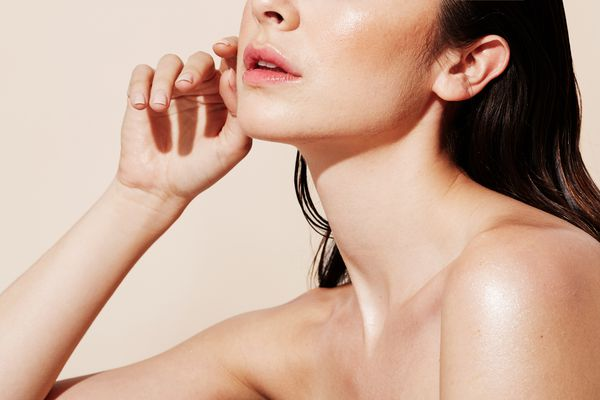 woman with bare skin and tinted lipstick