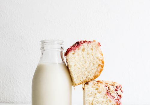 Milk bottle with cake propped on it