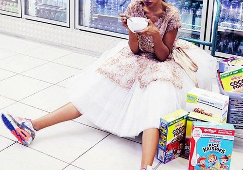 woman sitting on ground of convenience store in dress