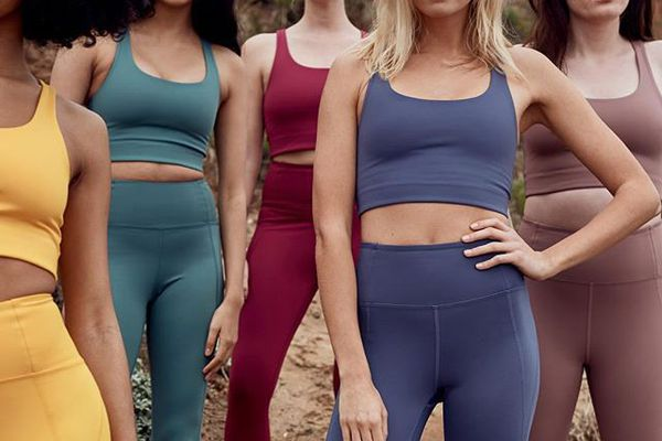 women in colorful workout clothes