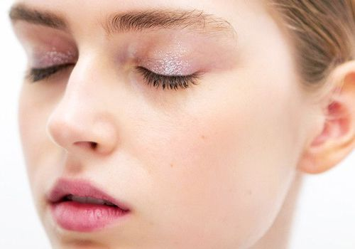 woman with closed eyes glitter eyeshadow