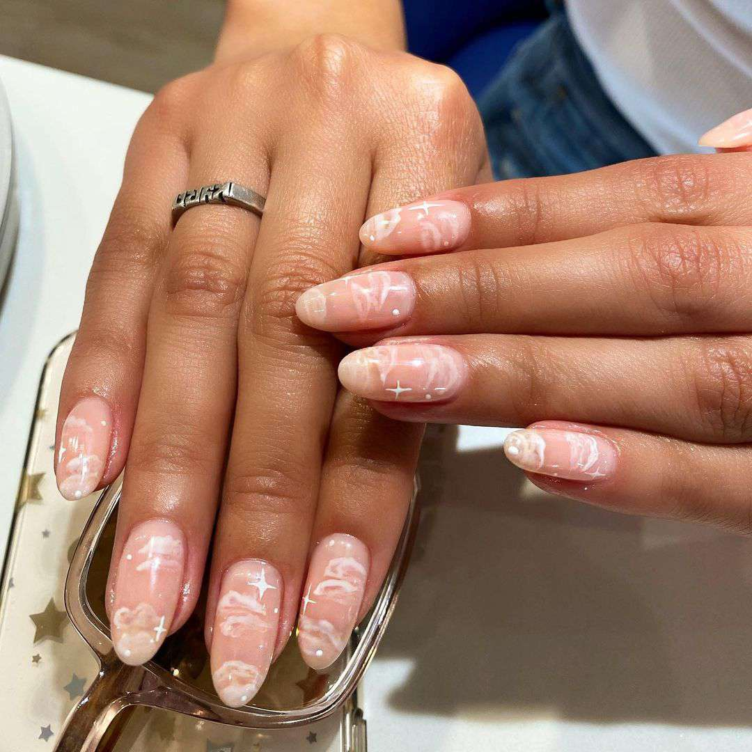 Person with dreamy neutral nails