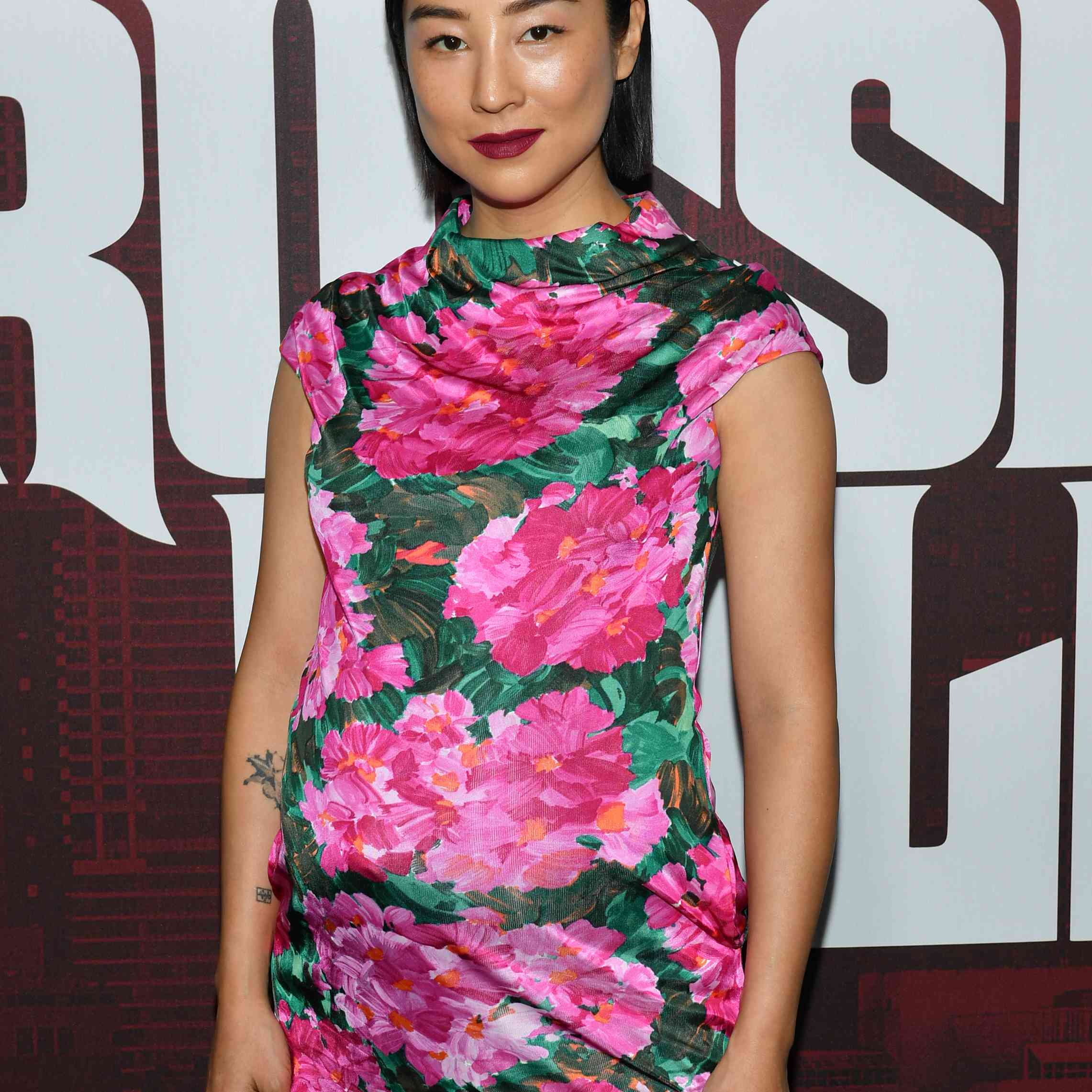 Greta Lee posing on the red carpet at Netflix's Russian Doll Season 1 premiere in New York City